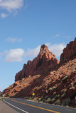 The road passes between red sandstone Stock Photo