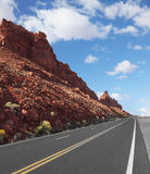 The  road passes rocks of sandstone Stock Photo