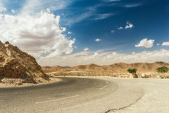 Road passes through rocky Sahara desert, Tunisia. Africa Stock Image