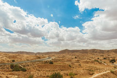 Road passes through rocky Sahara desert, Tunisia. Africa Royalty Free Stock Photos