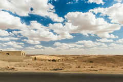 Road passes through rocky Sahara desert, Tunisia. Africa Royalty Free Stock Images