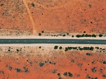 Road passing through desert outback royalty free stock photography