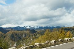 The road passing in the gorge at the foot of the Carpathian Mountains  near the town of Bran in Romania Royalty Free Stock Photos