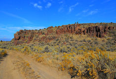 Road Past the Rocks. View along the road at Jasper Rocks - Crooked River National Grassland - near Culver, OR royalty free stock photos
