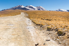 Road path mountains range ridge snow peaks, Bolivia. Road dirt path mountain ridge range peaks summits, Cordillera Real mountains, Bolivia traveling tourism Royalty Free Stock Photo