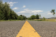 Road. The path to a distant road, with low angle shooting method royalty free stock photography