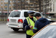 The road patrol service inspector of the police checks the documents of a taxi driver in Central Moscow. Royalty Free Stock Images