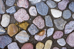 Road paved with colorful stone blocks. Royalty Free Stock Photography