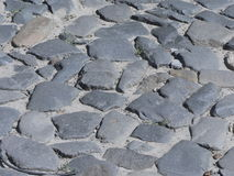 Road paved with natural stone; cobbled pavement Stock Photography