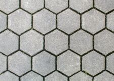 Road Paved With Hexagonal Sidewalk Tiles. Texture Of Light Gray Bricks Royalty Free Stock Photos