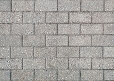 Road Paved With Sidewalk Tiles. Texture Of Light Gray Bricks Royalty Free Stock Photo
