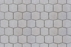 Road pavement texture background close up / Hexagon pattern cement sidewalk Stock Image