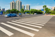 Pedestrian crossing zebra crosswalk city street Stock Photos