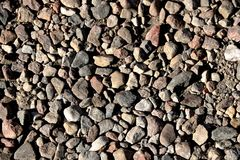The road, a pedestrian path made of stones of different shapes. Background Royalty Free Stock Image