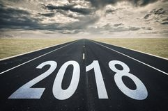 2018 Road perspective, dark clouds crisis concept. 2018 Road perspective, dark clouds, crisis concept Stock Photography