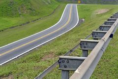 Road in perspective with highlight to the guardrail. Road in perspective to the horizon with highlight to the guardrail, in Sao Paulo state, Brazil Stock Images