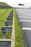 Road in perspective with highlight to the guardrail. Road in perspective to the horizon with highlight to the guardrail, in Sao Paulo state, Brazil Royalty Free Stock Images