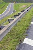 Road in perspective with highlight to the guardrail. Road in perspective to the horizon with highlight to the guardrail, in Sao Paulo state, Brazil Stock Photo