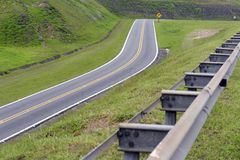 Road in perspective with highlight to the guardrail. Road in perspective to the horizon with highlight to the guardrail, in Sao Paulo state, Brazil Royalty Free Stock Photos
