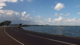 Road, perspective, lake, water, nature, travel , sky, blue, clouds Stock Photography