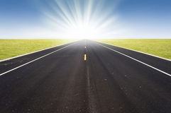 Road perspective. With rising sun Royalty Free Stock Image