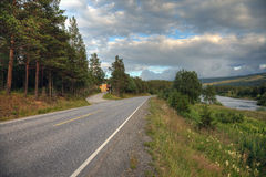 Road through picturesque norwegian landscape Stock Photos