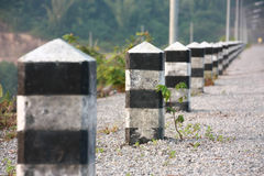 Road pillar. The row of pillars on the road Royalty Free Stock Photos