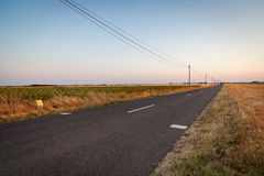 Road on plateau of Valensole, Provence, France Stock Photo