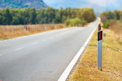 Road pole on highway. Royalty Free Stock Image