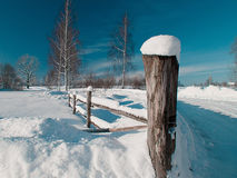Road pole under the snow. Winter landscape with road pole and trees at countryside road Royalty Free Stock Photography