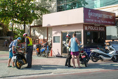 Road police check tourists on motorbike Royalty Free Stock Images