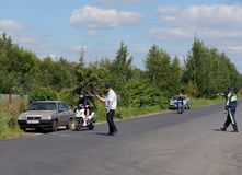Road police patrol inspectors stop motorbike drivers. royalty free stock photos