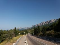 Road Ponizovka settlement area. Mountains, summer, highway, vineyards, june, nature, open air, transport, road marking Stock Image