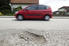 Road with potholes. Frost heave stock image