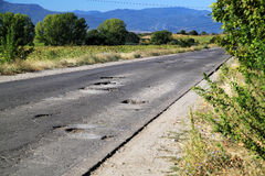 Road with Potholes Royalty Free Stock Photography