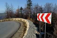 Road problems for drivers. Mountain road with dangerous curves. The scenery is wonderful royalty free stock image
