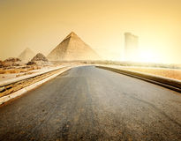 Road and pyramids Stock Image