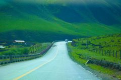 Road. Qilian mountains is one of the major mountain range in China, is located in the northeast of qinghai province and gansu province in the western border. It' Royalty Free Stock Photo