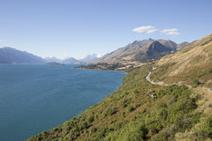 The Road from Queenstown to Glenorchy New Zealand. The Road along Lake Wakatipu from Queenstown to Glenorchy New Zealand Stock Photos