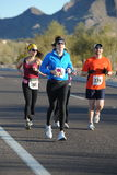 Road Race Runner. Female road race runner racing stock photos