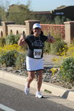 Road Race Runner. Female road race runner racing royalty free stock photography
