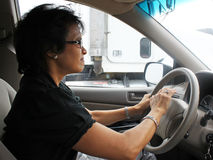 Road Rage. Frustrated woman driver middle-aged honking or slamming on the steering wheel Royalty Free Stock Photos