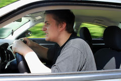 Road rage. Angry young male driver speeding very fast showing anger as roadrage Royalty Free Stock Images