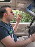 Road Rage. A young man seems to be experiencing some road rage while driving Royalty Free Stock Image