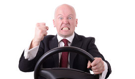 Road rage. Behind the wheel with clenched fist isolated on white background Stock Image