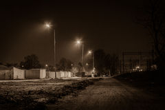 Railway and road by night Stock Images