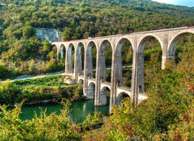 Road and railway viaduct of Cize Bolozon. An old stone viaduct with arch Royalty Free Stock Images
