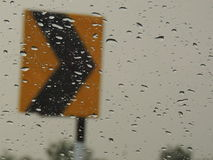 Road and rain. Combination of roadside signs with droplets of rain Royalty Free Stock Photos