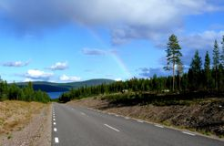 Road with rainbow Royalty Free Stock Photos