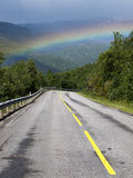 Road and rainbow landscape Stock Photo